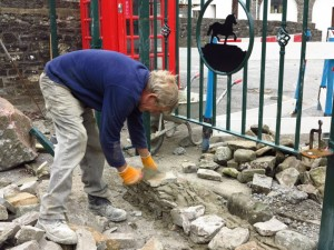 At work on the village hall's entranceway, which he built in autumn 2013