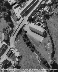 detail from an aerial photograph from 1975, showing the village hall with both entrance walls intact.