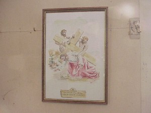 A painting of the Virgin Mary by Mario Ferlito hangs on the wall of the church